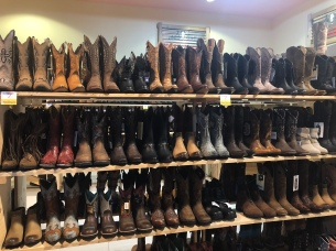One of the many rows of boots in the store.